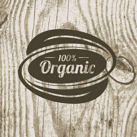 Organic product badge with leaves on wooden texture. Vector illustration background. Logo template. Illustration