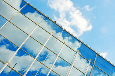 window reflection: Glass wall of the office modern building structure. Business architecture background. Window reflection. Stock Photo