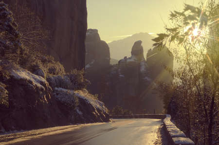 color tone: Sunset in the Meteora mountains. Road to the Meteora monasteries in winter.  Vintage color tone landscape with backlighting. Greece.