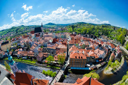 krumlov: Panoramic aerial view of historical center of Cesky Krumlov, Czech Republic. Spring or summer cityscape. Fisheye lens view of roofs of Cesky Krumlov.