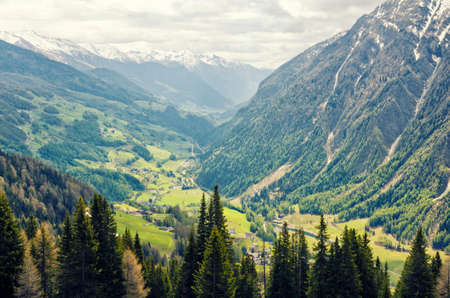 hochalpenstrasse: Beautiful view of Alps mountains. Spring in National Park Hohe Tauern, Austria. Green valley and snowy mountains peaks. Grossglockner high alpine road.