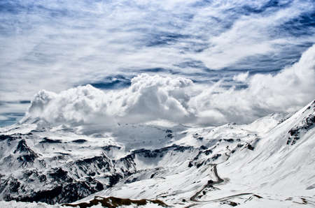 hochalpenstrasse: Beautiful view of Alps mountains. Snowy peaks in clouds. National Park Hohe Tauern, Austria. Grossglockner high alpine road. Stock Photo