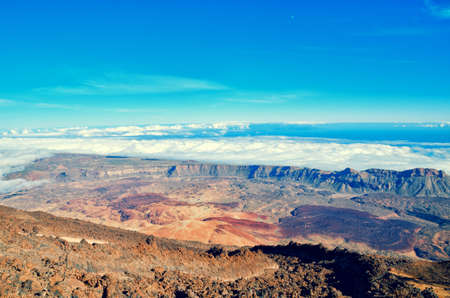 stratovolcano: Beautiful aerial view of volcano caldera from summit Pico del Teide mountain. Lava rocks and volcanic Mars landscape in El Teide National park. Main landmark on Tenerife, Canary Islands, Spain. Stock Photo