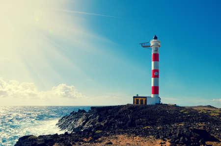 playa: Old lighthouse in Punta de Abona beach. Landmark on the south of Tenerife, Canary islands, Spain. Stock Photo