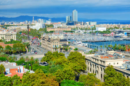 Aerial view of Barcelona. Passeig de Colom avenue and Columbus monument, La Barceloneta and Port Vell. Catalonia, Spain.