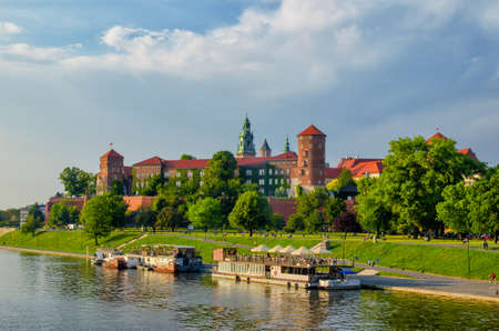 Wawel castle famous landmark in Krakow Poland. River Wisla view. Summer or spring green landscape.