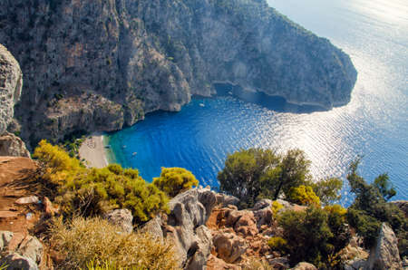 Aerial view of Butterfly valley in Oludeniz. Sunny summer beach landscape top view. Fethiye, Turkey nature landmark.
