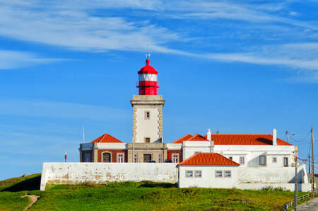 Old red lighthouse building at Cape Roca. Cabo da Roca most western point in Europe. Zdjęcie Seryjne