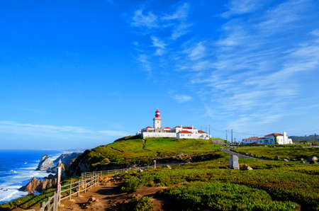 Cape Roca and old red lighthouse. Cabo da Roca most western point in Europe. Travel tourism landmark in Sintra and Lisbon, Portugal.