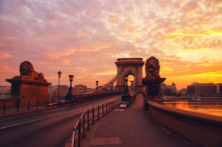 Silhouette of Chain Bridge  of a beautiful yellow pink sunrise in Budapest.