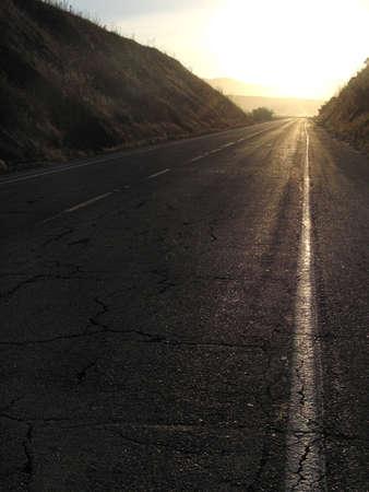 Sunrise lights up a road Stock Photo