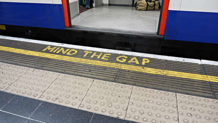 Mind the gap sign at underground train station. Caution sign for safety.