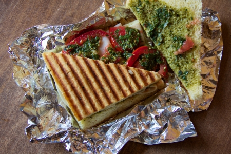 foil: Panini with turkey, pesto, and red peppers on aluminum foil