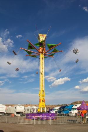 vertigo: Vertigo ride against blue sky and clouds at Navajo Nation Fair Editorial