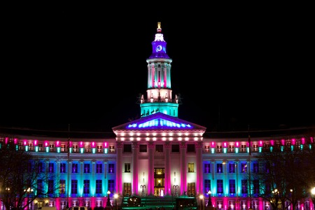 Holiday lights Denver, City and County Building, sky blue and fuchsia