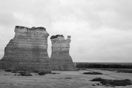 Monument Rocks, Kansas, wide view of two buttes on left, black and white photo