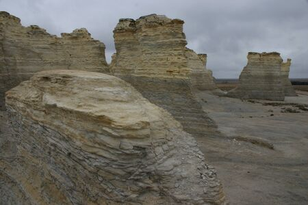 Monument Rocks, Kansas, wide view left to right with camel-shaped butte on right Banco de Imagens