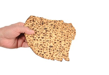 unleavened: Sharing a piece of matzah.