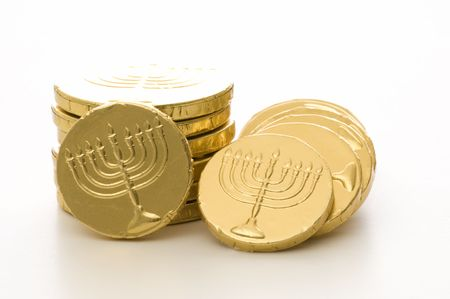 Hanukkah gelt stacked set against a white background.