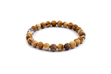 Bracelet beads stock images. Bracelet with buddha head. Jewel on a white background. Buddha Bracelet Stock Photo