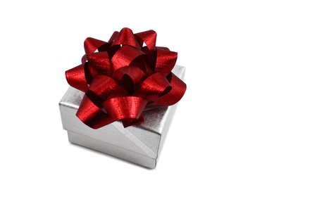 Gift box with bow stock images. Gift box with red bow on a white background. Red bow image. Christmas silver box with bow