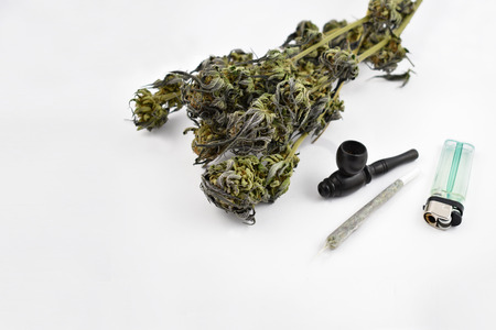 Marijuana stock images. Smoking accessories on a white background. Set of cannabis products. Marijuana isolated on a white background