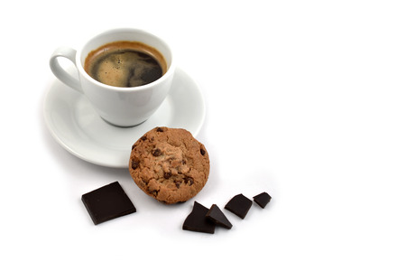 Chocolate cookies with coffee stock images. Cup of coffee on a white background. White cup of coffee with snack. Cup of coffee with cookie. Espresso with sweetness