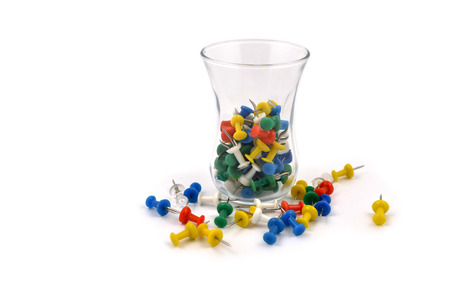 Thumbtacks in a glass stock images. Tack on a white background. Multicolor plastic tacks. Set of color pins