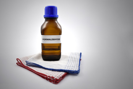Formaldehyde stock images. A bottle of formalin with inscription. Formaldehyde and handkerchief Stok Fotoğraf