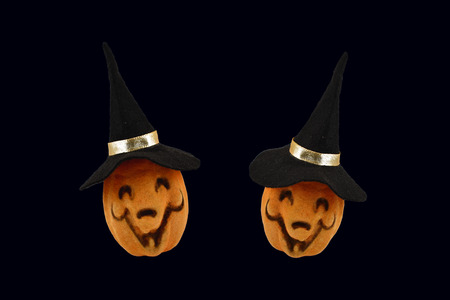 Two Halloween Pumpkins stock images. Haloween pumpkin isolated on a black background. Pumpkin with a witch hat Stock Photo