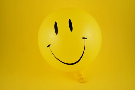 Happy emoji balloon stock images. Yellow balloon stock images. Smiley inflatable balloon isolated on white background. Laughing party balloon Zdjęcie Seryjne