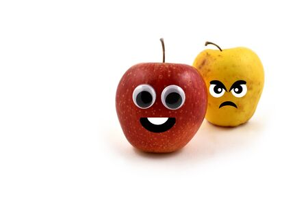 An apple and angry apple stock photography. Cheerful apple character. Red apple on white background. Laughing apple cartoon icon. Funny figure of apple. Fresh apple  old apple. Jealous old apple