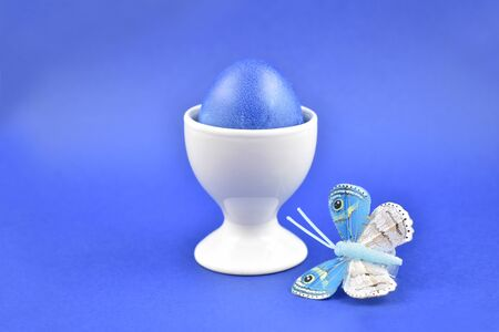 Blue decorated easter egg stock images. Spring decoration images. Ceramic egg stand with blue egg. Easter decoration