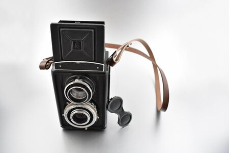 Old camera stock images. Vintage camera on silver background. Old black Twin lens reflex camera