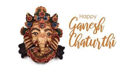 Happy Ganesh Chaturthi illustration. Ganesha head stock images. Ganesha statuette isolated on a white background. Elephant head. Hindu festival celebrating the birth of Ganesha. Important day Stock Photo