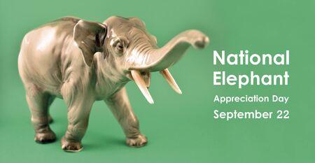National Elephant Appreciation Day illustration. Realistic elephant statue. Figurine elephant stock images. Elephant isolated on white background. Important day Banco de Imagens