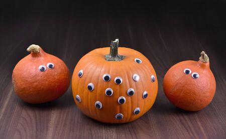 Halloween pumpkin. Halloween pumpkins on wooden background. Scary halloween pumpkin