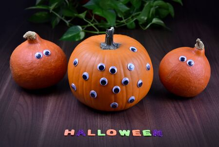 Halloween pumpkin. Three halloween pumpkins with eyes. Funny halloween pumpkin. Pumpkins with Inscription Halloween