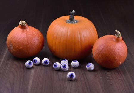 Halloween pumpkin. Three halloween pumpkins with chocolate eyes. Creepy halloween pumpkin