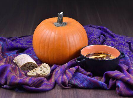 Pumpkin soup stock images. Bowl of pumpkin soup with bread. Pumpkin soup still life. Fresh homemade pumpkin soup stock images