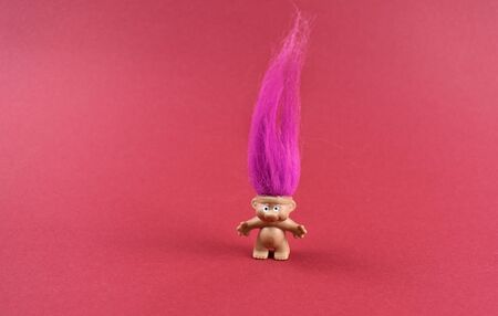 Troll figure stock images. Elf on a pink background. Troll with pink hair. Troll girl figure. Troll toy images Stok Fotoğraf