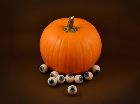 Halloween pumpkin. Single halloween pumpkin with chocolate eyes. Halloween pumpkin on a dark background. Stock photography Halloween pumpkin