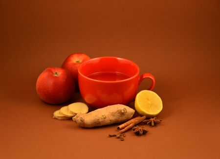 Ginger tea with lemon and cinnamon stock images. Autumn still life with tea, ginger and apples. Red mug with tea. Healthy food when sick stock images. Vitamin bomb stock images. Cup of tea stock images