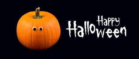 Happy Halloween sign. Halloween pumpkin. Halloween pumpkin with eyes on black background. Black banner with orange halloween pumpkin. Happy Halloween greeting card Фото со стока