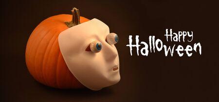 Happy Halloween sign. Halloween pumpkin. Black banner with orange halloween pumpkin. Happy Halloween greeting card. Plastic human mask on pumpkin Фото со стока - 132369504