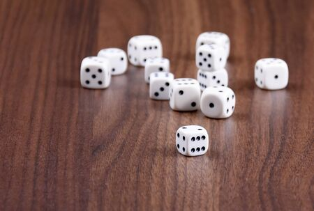 Playing dice stock images. White dice on wooden background. Playing dice on the table. Playing dice on wooden background with copy space for text