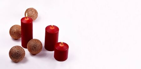 Red Christmas Candles stock photography Red Christmas candles on a white background. Three red candles with balls. Red Christmas candles on white background Фото со стока - 132369510