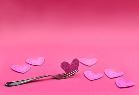 Pink background stock photography Heart on fork. Heart shape on pink background. Sweet pink banner. Sweet heart on pink background with copy space for text Stock Photo - 132047890