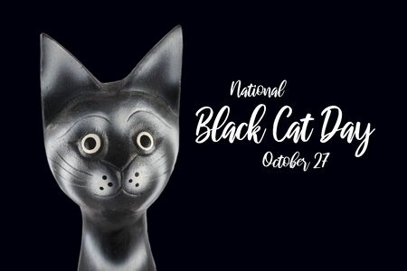 National Cat Day images. Black head cat images. Wooden cat decoration. Cat on a black background. Head cat isolated on black background. Important day Фото со стока