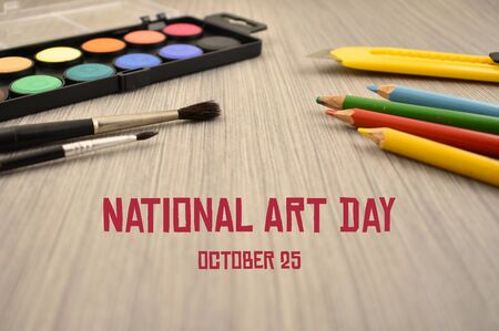 National Art Day images. Art supplies on wooden background. School supplies for painting. Art tools on the table. Art Day Poster, October 25th. Important day